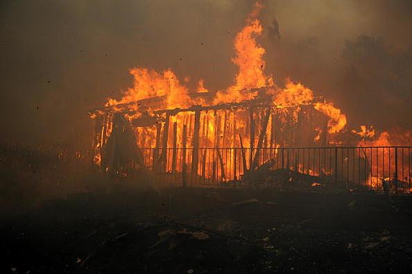 A building burns at the Oakridge Mobile