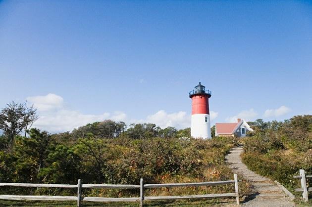 Trail leading toward a lighthouse