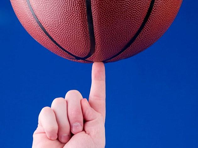 Man balancing basketball on finger