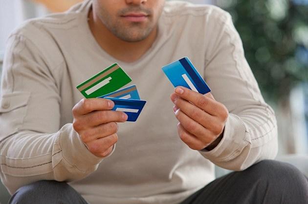 Hispanic man choosing credit cards