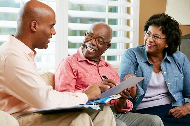 Financial Advisor Talking To Senior Couple At Home