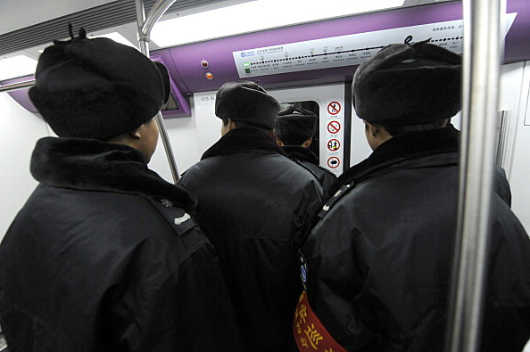 Metro security personnel ride on the tra