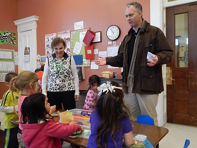 Foster Grandparent Ellie Motta and Mayor Jon Mitchell talk with children at Pace Head Start