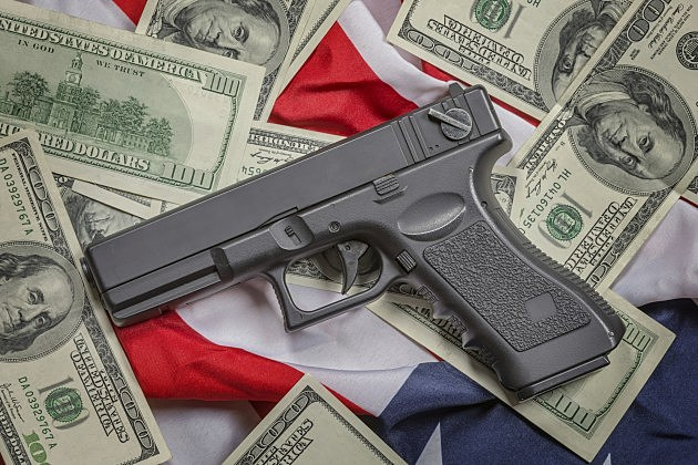 Gun with American money