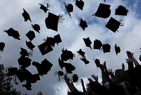 Students Toss Mortar Boards in the Air