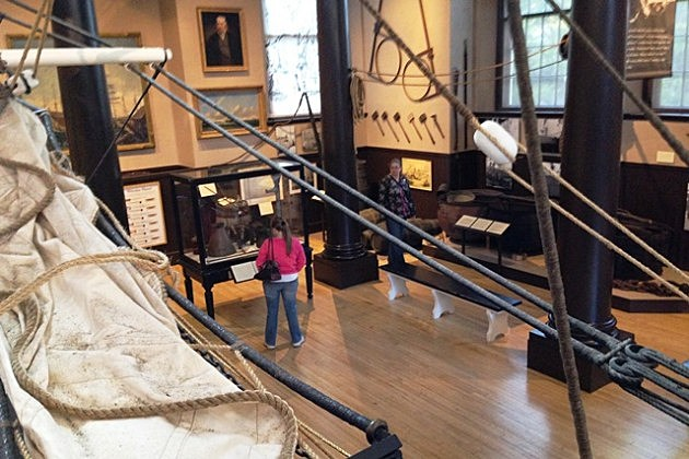 Visitors explore the New Bedford Whaling Museum