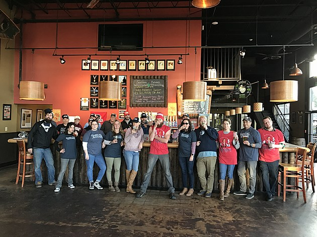The team at the SweetWater taproom wore Sam Adams gear while serving up Patriot Pale Ale. | Photo courtesy of SweetWater Brewing