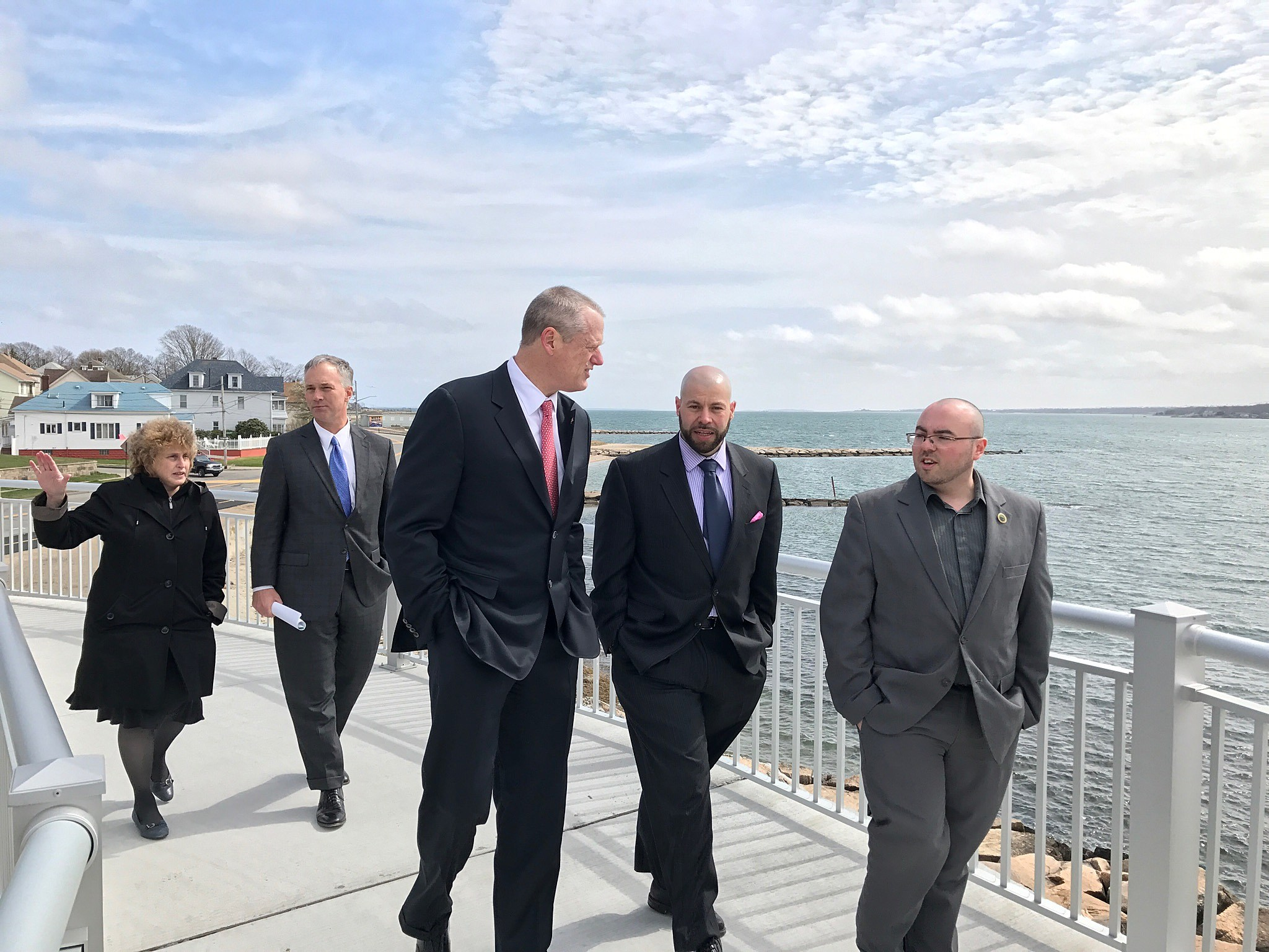 Officials walked the newly opened CoveWalk in New Bedford's south end Wednesday. Greg Desrosiers/TSM