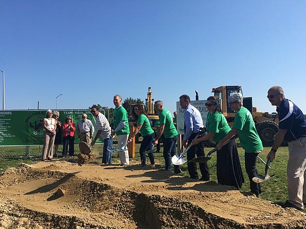 Shovel's hit the ground at the groundbreaking ceremony for Noah's Playground. Tim Dunn/TSM.
