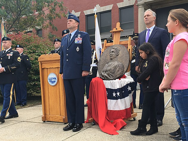 Major General Gary Keefe of the Mass. National Guard (left) stands at attention with Mayor Jon Mitchell and students during unveiling of historic bronze relief of DeValle. Tim Dunn/TSM.